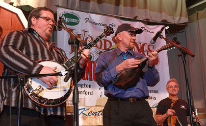 "Four-time national banjo champion Gary ""Biscuit"" Davis plays with Joe Dant, center, and Ray Mattingly during the Friday night jam session."