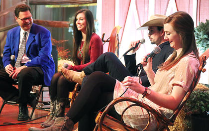 Brad Lanham, president of the Kentucky Fellowship of Musicians, talks to the members of Flatt Lonesome. Pictured, from left, are Lanham, Charli Robertson, her twin brother Buddy Robertson and their sister Kelsi Harrigill.