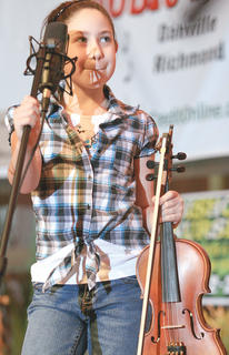 """Amber Keene, 9, took her first violin lesson Saturday morning during a workshop at the Kentucky Bluegrass Music Kickoff, and that evening, she played """"Mary Had A Little Lamb"""" on stage during the dinner show."""