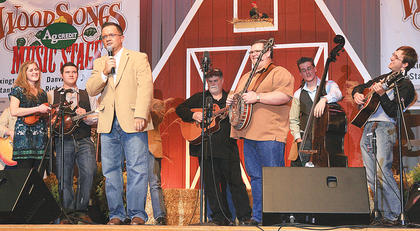 Emcee Jeremy Bowman seeks requests from the crowd during a jam session Friday night at the Kentucky Bluegrass Music Kickoff.