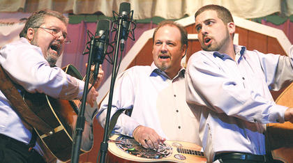 From left, Mike Johnson, David Nance and Blake Johnson of the Hagar's Mountain Boys sing Saturday night. This is the fourth year the band has performed at the Kentucky Bluegrass Music Kickoff.