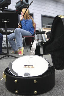 "Kimberly Hmurovic of Greensburg takes a banjo workshop with Gary ""Biscuit"" Davis Saturday morning."