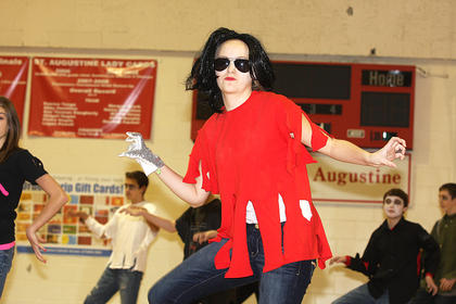 "Carly Mattingly, eighth grade, performs a dance routine to ""Thriller"" with her classmates."