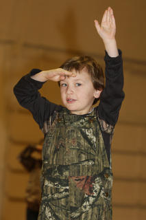 Landen Knopp, kindergarten, has his eye on the camera as he performs his song and dance.