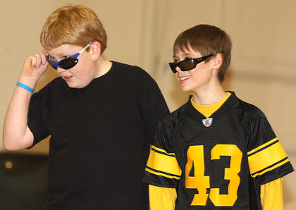 Zachary Mullins and Cade Thompson, fifth grade, look cool in their cheap sunglasses.