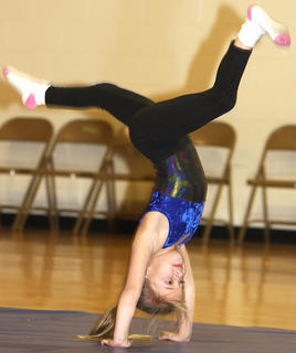 Brooklyn Mattingly, first grade, performs a gymnastics routine.