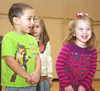 """St. Augustine Grade School celebrated Catholic Schools Week recently with many events, one being a school-wide talent show. Preschool students Tim Bland and Jenna Mullins perform the """"Body Rock"""" during the talent show with their fellow classmates. Also pictured is Julia Rose Wheatley."""