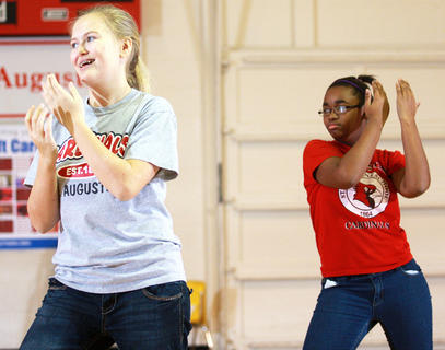 St. Augustine held it's annual student talent showcase Feb. 3. The showcase coincided with Catholic Schools Week, which promotes the value of Catholic education. Carly Mattingly, left, and Arieyon Smith perform a dance routine with the rest of the seventh grade girls.
