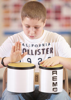 Zach Shepperson (a sixth grader) was visiting St. Augustine last Friday, but he joined in the showcase by playing the bongos.