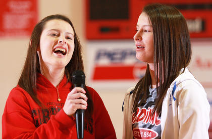 Sisters Katelyn, left, and Samantha Daugherty demonstrate their vocal talents. They are in the eighth grade.