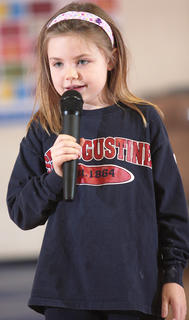 Second-grader Abbey Hickey does a short stand-up comedy routine.