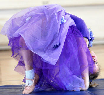 Kindergartner Brooklyn Mattingly shows her flexibility during a dance performance.
