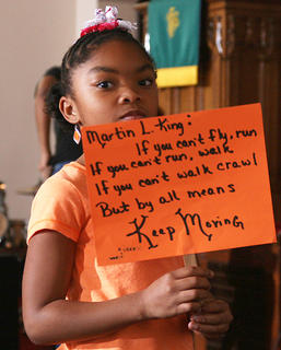 The Marion County Arts and Humanities Council hosted its Black History Celebration on Saturday at the Lebanon Presbyterian Church. Choirs from Bardstown, Campbellsville and Springfield performed along with Gary Vidito and the Marion County Youth Dancers. Makhia Gunn of the Marion County Youth Dancers carries a sign with a quote from Martin Luther King Jr.