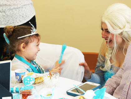 Aria Beard was dazzled by Queen Elsa at the tea party.
