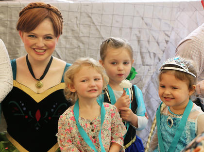 Princess Anna poses for a photo with her new friends.