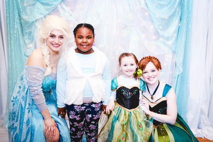 Elsa, Faith Shively, Lucy Bland and Anna enjoy their time at the Frozen tea party.