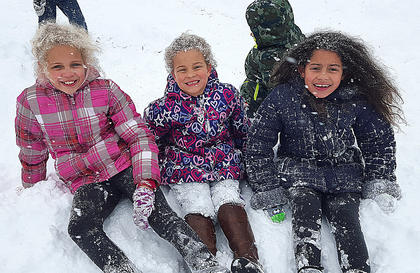 Pictured are Kaylee, Kyra and Chloe Logan playing in the snow in Loretto.