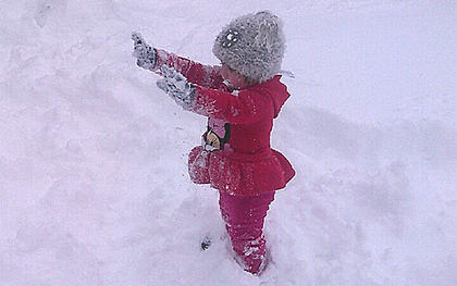 Adalyn Abell, 2, of Lebanon enjoys her first snow experience on Jan. 23. She's the daughter of Phillip and Jodi Abell.
