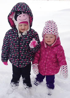 Sophie and Lilly Ballard enjoy their first time in the snow!