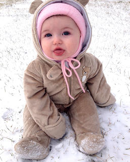 Lucy Bland, six months, enjoyed a very brief sit outside in her first snow. She is the daughter of Brian and Amy Bland.