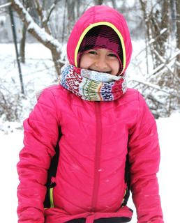 Nora Mitchell is all bundled up in her pink coat and ready to have some fun in the snow. Photo taken by Lisha Mitchell.