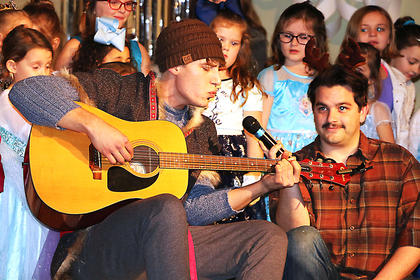 Kristoff and trusty sidekick Sven sing a quick song during the Frozen Tea Party at Centre Square on Saturday, Feb. 17.
