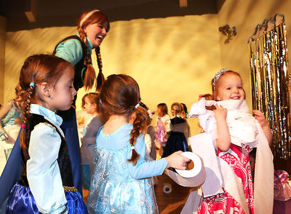 Princess Anna shares a laugh with guests during a game of making toilet paper snowmen at the Frozen Tea Party at Centre Square on Saturday, Feb. 17.