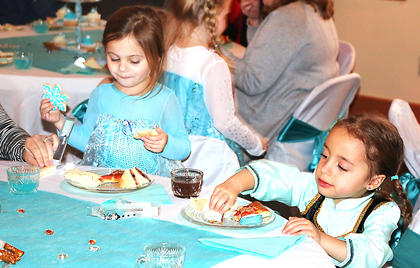 Two Anna and Elsa look-alikes enjoy tea and treats at the Frozen Tea Party at Centre Square on Saturday, Feb. 17.