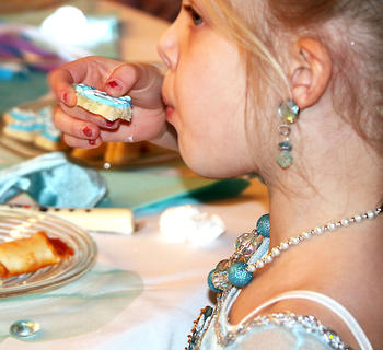 A guest takes a bite out of a special Frozen-themed cookie at the Frozen Tea Party at Centre Square on Saturday, Feb. 17.