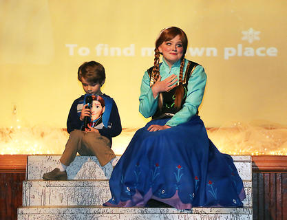 Princess Anna sings along with Ben Palagi, standing in for Prince Hans at the Frozen Tea Party at Centre Square on Saturday, Feb. 17.