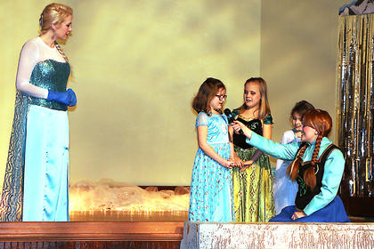 Queen Elsa and Princess Anna sing with three special guests at the Frozen Tea Party at Centre Square on Saturday, Feb. 17.