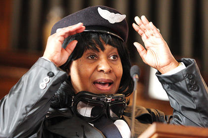 Ruth Ann Fogle portrays Bessie Coleman - the first African American woman to earn a pilot's license.
