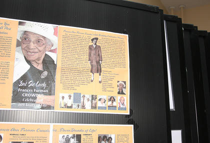Visitors can flip through panels with information about a variety of individuals and events.