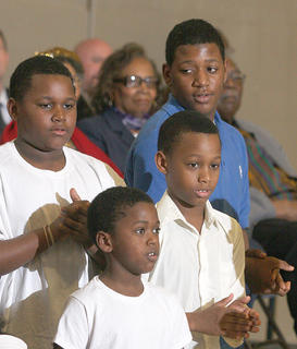 From left, Mike Railey, Tobia Railey, Amarion Railey and Christopher Railey sing with the Children of Zion from Springfield sing at Sunday's black history celebration at Centre Square.