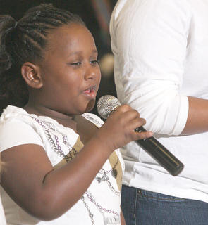 Letia Railey sings with the Children of Zion from Springfield sing at Sunday's black history celebration at Centre Square.
