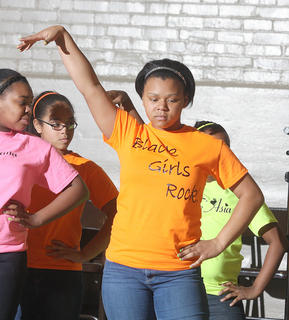 Mya Gunn let everyone know that black girls rock during a dance routine by the LEB Step Team during Sunday's black history celebration.