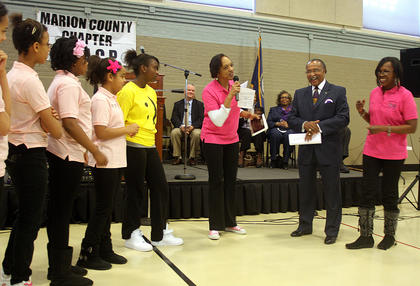 Members of the Marion County Youth Center present NAACP President Jerry Evans with a special award to show their appreciation for all he has done for the center.