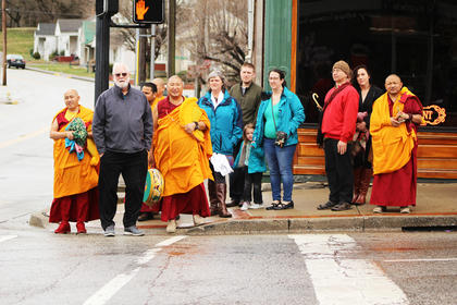 The monks led the crowd on local onlookers down Main Street and toward the stream on Proctor Knott in the sand pouring ceremony at the end of their week stay.