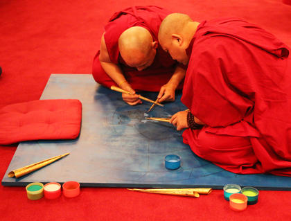 The monks began working on their sand mural on Tuesday, Feb. 19