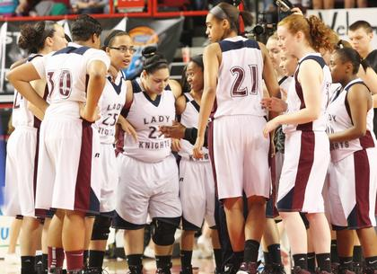 The Lady Knights huddle up before the start of the game against Walton-Verona in the first round of the state tournament.