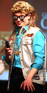 "Brydon Brett performs to the once popular Billy Ray Cyrus song ""Achy Breaky Heart."""
