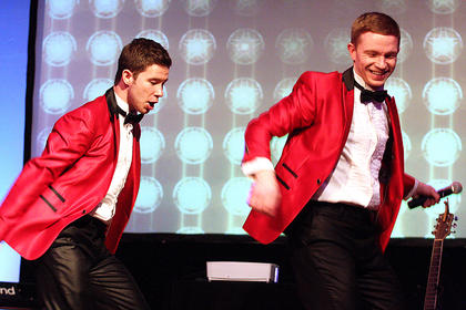 The Brett brothers, Garon, left, and Brydon, perform a dance routine together.
