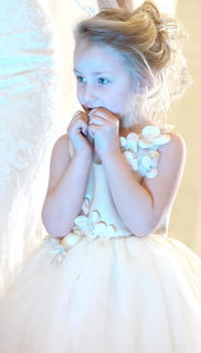 Addison Brockman plays the role of a flower girl.