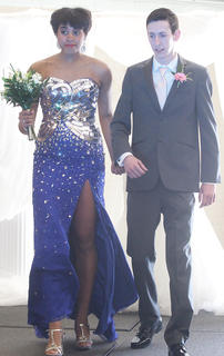 Alexus Calhoun walks alongside Austin Hughes.