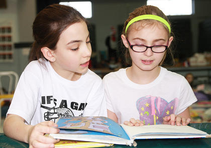 Lexie Wilkerson, left, and Paris Dye took turns reading aloud as they shared a book.