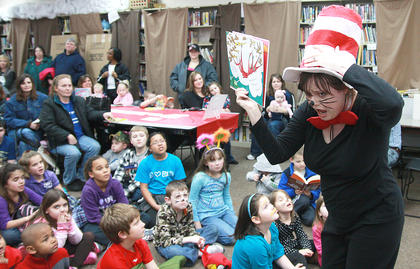 "Local schools and the Marion County Public Library held events to promote literacy in conjunction with Dr. Seuss's birthday last week. Children's librarian Patty May Brown reads ""Marvin K. Mooney Will You Please Go Now!"" at the start of the Dr. Seuss party Thursday afternoon."