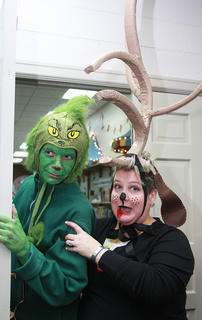 The Grinch (cataloger Terry Brockman) and his dog Max (young adult librarian Elaine Rahn) make an appearance at the party.