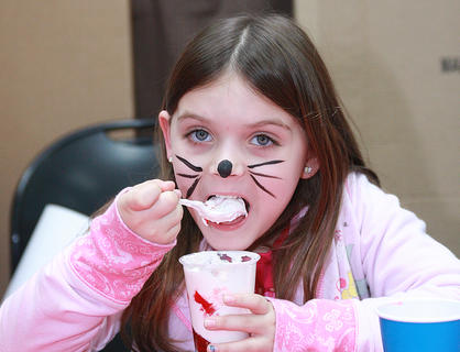 "Ashlynne Black, 5, enjoys a red-and-white parfait inspired that ""The Cat in the Hat."""