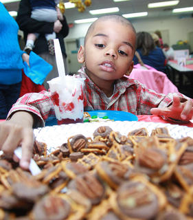 Jacob Smalley, 4, scoops up some Yertle's caramel turtles.