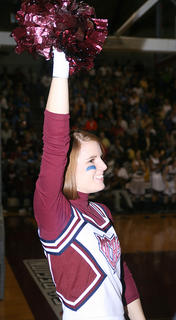 DeLanna Johnson cheers for the Lady Knights.
